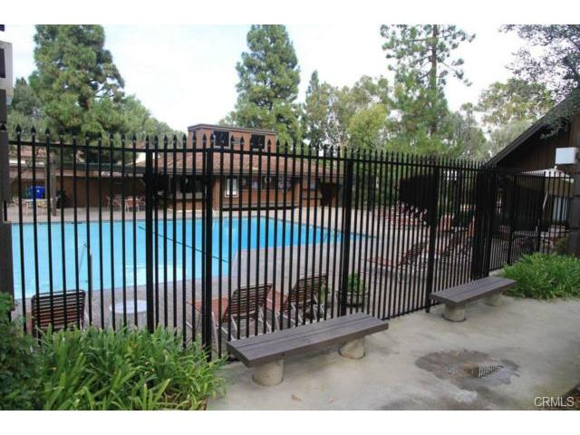 Huge community pool, fully and securely fenced for safety.