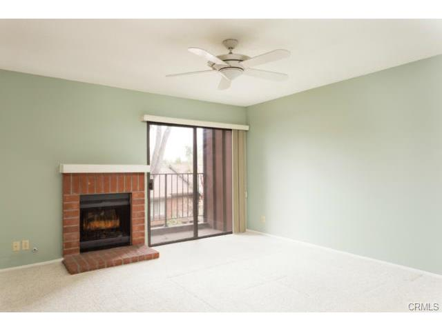 Master bedroom fireplace and slider to balcony